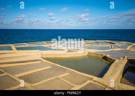 Salt evaporation ponds on Gozo island, Malta - Stock Photo