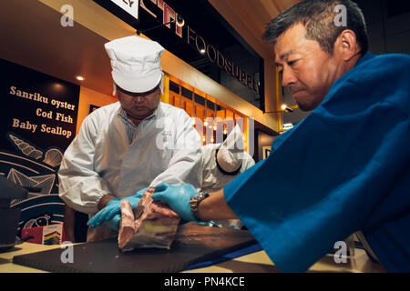 Tokyo, Japan - September 10, 2018 : japanese butchers are cutting and decorating highest meat grade of marbling A5 japanese wagyu beef for barbecue or - Stock Photo