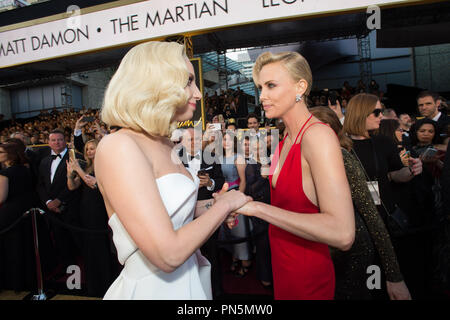 Oscar®-nominee Lady Gaga and Charlize Theron arrive at The 88th Oscars® at the Dolby® Theatre in Hollywood, CA on Sunday, February 28, 2016.  File Reference # 32854_349THA  For Editorial Use Only -  All Rights Reserved - Stock Photo