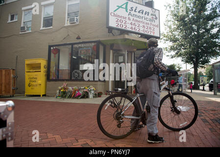 Washington, DC, USA. 20th Sep, 2018. A makeshift memorial is erected outside the takeout restaurant where Wendy Martinez sought help after being fatally stabbed while jogging in Northwest DC on Wednesday. Credit: Erin Scott/ZUMA Wire/Alamy Live News - Stock Photo