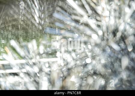 background of silver bokeh from Christmas holiday tinsel for Christmas and greeting cards - Stock Photo