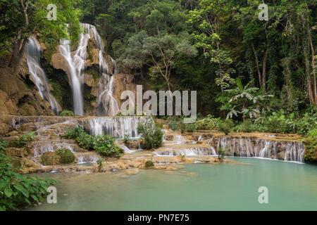 Beautiful view of the main fall at the Tat Kuang Si Waterfalls near Luang Prabang in Laos. - Stock Photo