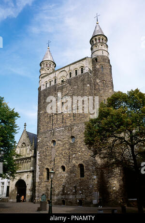 Netherlands. Maastricht. Basilica of Our Lady (Basiliek van Onze-Lieve-Vrouw). Romanesque style church. View of Entrace Merode Chapel and westwork. A 13th-century Gothic portal, rebuilt in the 15th century, provides access to the church as well as to the so-called Mérode chapel (or Star of the Sea chapel). The westwork, built of carbonic sandstone, dates from the early 11th century and is flanked by two narrow towers with marlstone turrets. - Stock Photo
