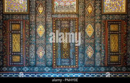 Floral ornaments of wooden embedded cupboards painted with colored geometrical patterns, Syrian hall of historic Manial palace of Prince Mohammed Ali - Stock Photo