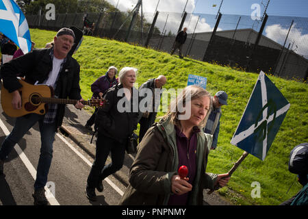 Faslane, Scotland, on 22 September 2018. 'Nae (No) Nukes Anywhere' anti-nuclear weapons demonstration at the Faslane Peace Camp and walking to a rally outside HM Naval Base Clyde, home to the core of the UK's Submarine Service, in protest against Trident nuclear missiles. The rally was attended by peace protestors from across the UK who came 'to highlight the strength of support from many UN member states for Scotland, a country hosting nuclear weapons against its wishes'. Photo Credit Jeremy Sutton-Hibbert/ Alamy News. - Stock Photo