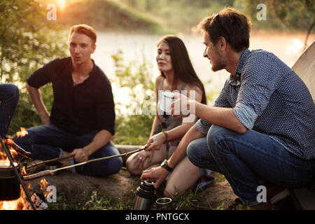 evening rest on the bank of amazing river - Stock Photo