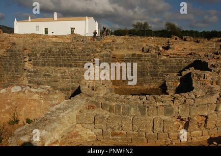 Ruins of Milreu. Roman Villa (1st - 4th century A.D.). In the foreground, the Baths. Behind, a sixteenth century house. Estoi, near Faro. Algarve. Portugal. - Stock Photo