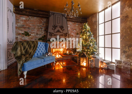 gifts at the Christmas tree. Christmas evening by candlelight. classic apartments with a fireplace. - Stock Photo