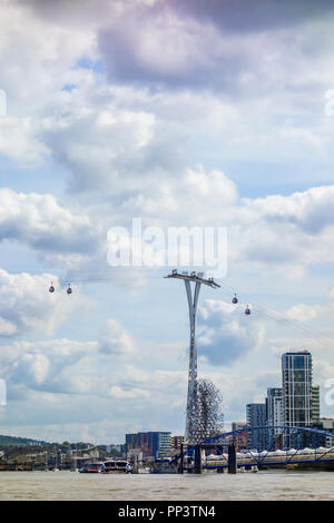 One of the pylons that carries the Emirates Air Line cable car across the London docklands. - Stock Photo