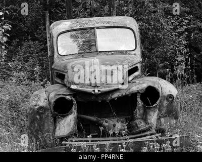 ruined cars in black and white in various monochrome tones - Stock Photo
