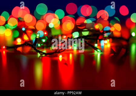 Christmas lights with blurred background - Stock Photo