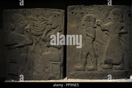 Orthostat with relief depicting a banquet (left) and males walking (right). 9th century BC. Basalt. Late Hitite Period. From the west side of citadel gate, Sam'al (Sinjerli). Archaeological Museum. Museum of Ancient Orient. Istanbul. Turkey. - Stock Photo