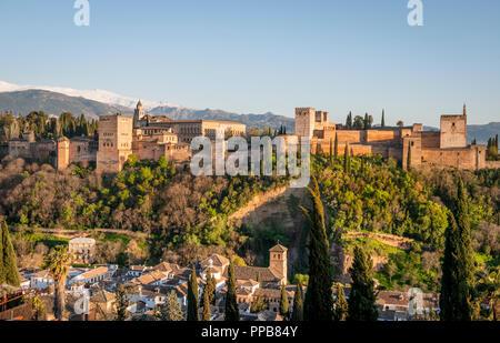 Alhambra on the Sabikah hill, Moorish citadel, Nasrid palaces, Palace of Charles the Fifth, behind Sierra Nevada with snow - Stock Photo
