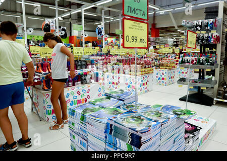 Sofia, Bulgaria, August 17,2018:young boy and girl looking at pencils, notebooks behind them, school supplies in a supermarket, back to school concept - Stock Photo