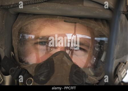 Capt. Logan Mitchell, 52nd Operation Support Squadron aircrew flight equipment flight commander, goes through decontamination training at Spangdahlem Air Base, Germany, Aug. 23, 2018. This training was designed to simulate pilots landing in a potentially contaminated environment. - Stock Photo