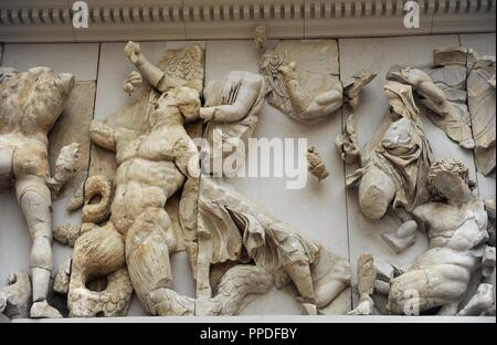 Pergamon Altar. Built by order of Eumenes II Soter. 164-156 BC by artists of the school of Pergamon. Marble and limestone. North frieze. Orion and Enyo.  Pergamon Museum. Berlin. Germany. - Stock Photo