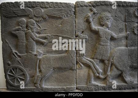 Hittite art. Orthostat. 8th century BC. Relief: Hunting scene with trolley. 750 BC. Found in old city of Sma'al /Zincirli (Turkey). Pergamon Museum. Museum Island. Berlin. Germany. - Stock Photo