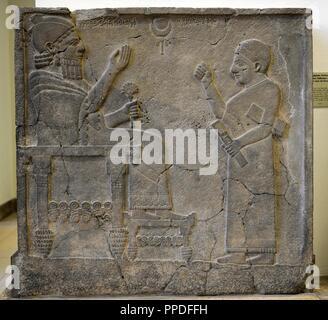 Hittite art. Orthostat or stele of King Bar-Rakib (Barrakit 744-727 BC)  sitting on the throne .750 BC. Zone of Sma'al /Zincirli (Turkey) to South of Turkey. Detail. Pergamon Museum. Museum Island. Berlin. Germany. - Stock Photo