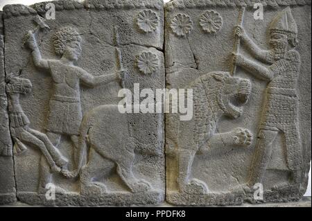 Hittite art. Orthostat. 8th century BC. Relief: Hunting a lion. Found in old city of Sma'al /Zincirli (Turkey). Pergamon Museum. Museum Island. Berlin. Germany. - Stock Photo