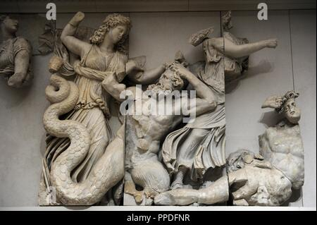 Pergamon Altar. Built by order of Eumenes II Soter. 164-156 BC by artists of the school of Pergamon. Marble and limestone. North frieze. The three Moirai, goddesses of fate, kill the Giants Agrios and Thoas with bronze clubs. Pergamon Museum. Berlin. Germany. - Stock Photo