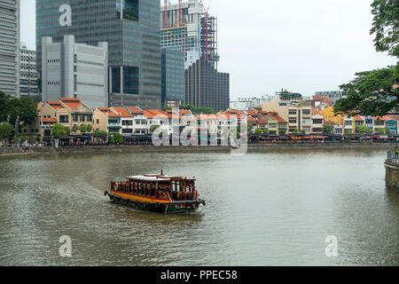 The Beautiful Boat Quay Housing Restaurants with Passenger Taxi Boat on Singapore River South Bank Singapore - Stock Photo