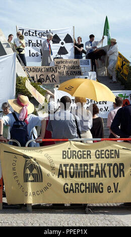 Nuclear opponents and the Mutter gegen Atomkraft (Mothers Against Nuclear Power) (above left Gina Gillig) protest against the opening of the new Neutron Research Source FRM-II of the Technical University of Munich. - Stock Photo