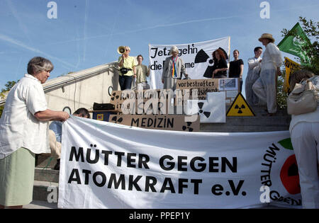 Nuclear opponents and the Mutter gegen Atomkraft (Mothers Against Nuclear Power) protest against the opening of the new Neutron Research Source FRM-II of the Technical University of Munich. - Stock Photo