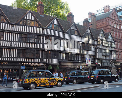 View of the half timbered front facade of Staple Inn in High Holborn London - Stock Photo