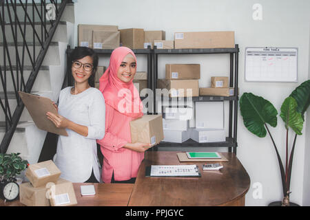 online shop seller working at home office - Stock Photo
