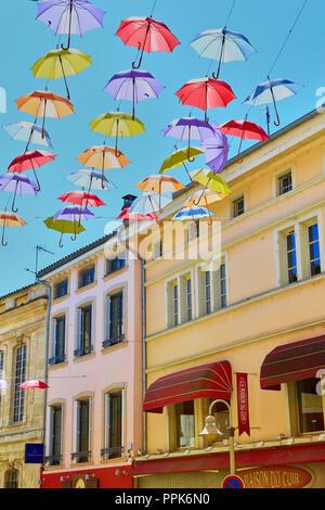 Macon. Colorful umbrellas hanging on the streets. Saône-et-Loire, Bourgogne-Franche-Comté. France. Eurppe - Stock Photo