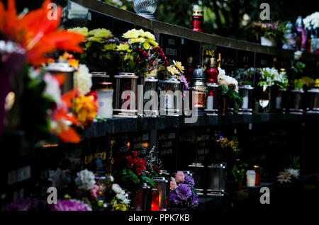 colorful candles during All Saints Day at the cemetery - Stock Photo