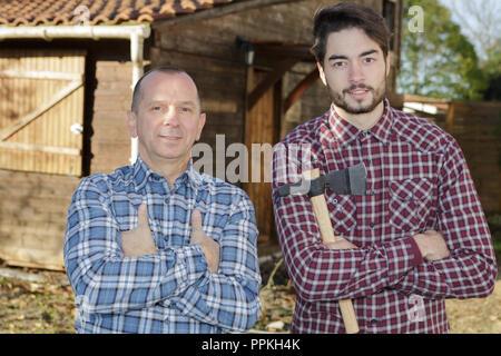 two lumberjacks outside building - Stock Photo