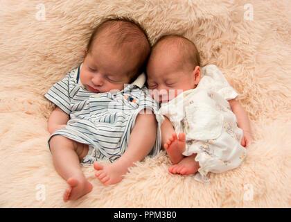 Horizontal portrait of premature twin newborn babies. - Stock Photo