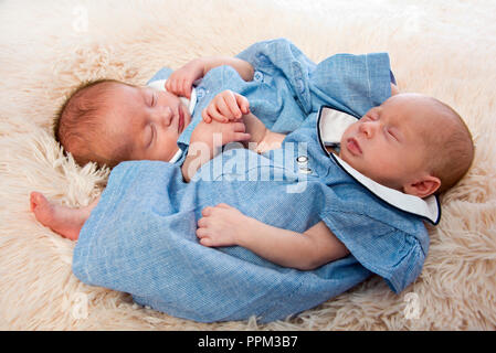 Horizontal portrait of premature twin newborn babies. - Stock Photo