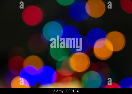 Colorful bokeh lights. Abstract Christmas background. - Stock Photo