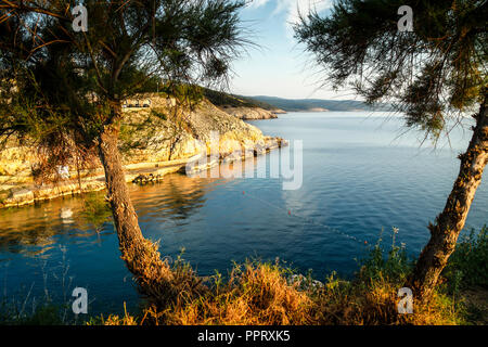 The beautiful coastline view of the Adriatic sea at sunset from the small Croatian village of Vrbnik on the island of Kr - Stock Photo