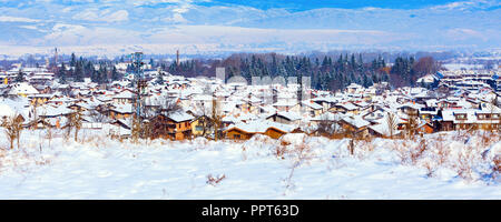 Houses with snow roofs panorama banner of bulgarian ski resort Bansko, Bulgaria - Stock Photo
