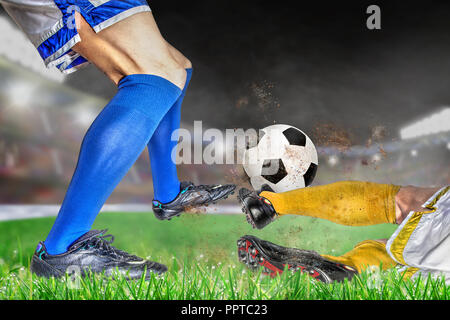 Soccer players in action with football in brightly lit outdoor stadium. Focus on foreground and soccer ball with shallow depth of field on background  - Stock Photo