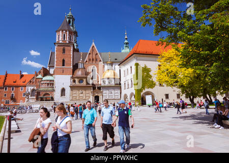 Krakow, Poland : Tourists walk around Wawel Cathedral on the Wawel Hill. First built and destroyed in the 11th century; the construction of the curren - Stock Photo