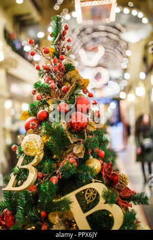 Photo of decorated Christmas tree in store - Stock Photo