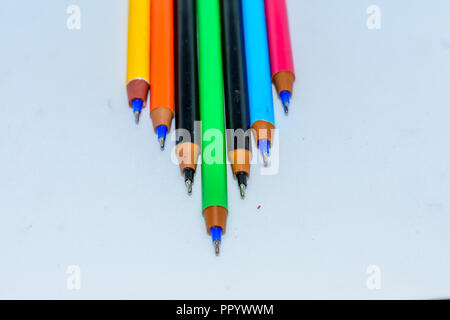 Set of multi-colored pens, tools for writing drawing, isolated on white. - Stock Photo