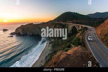 Sunset over Bixby Creek Bridge, Big Sur, California, United States of America, North America - Stock Photo