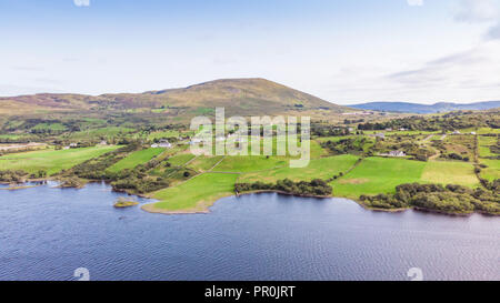 An aerial view of meadows on the shores of a lake in the Connemara area of Ireland. - Stock Photo