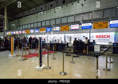 Almaty, Kazakhstan - September, 2018: Almaty airport departure terminal check-in counter area. The Almaty airport is the largest international airport - Stock Photo