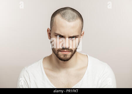 Nervous, doubtful, unhappy, frustrated man frowning his eyebrow - Stock Photo