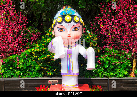 A female cartoon like Chinese folk culture character outside the folk village scenic area in Overseas Chinese town in the city of Shenzhen China. - Stock Photo