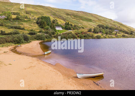 An aerial view of two boats on the beach at scenic Lough Nafooey in the Connemara region of Ireland. - Stock Photo