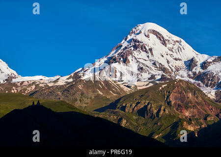 Georgia,  Caucasus, Stephantsminda, Kazbegi, Kazbek Mount 5047m, Gergeti Trinity Church - Stock Photo