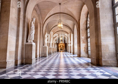 Versailles, France - March 14, 2018: An empty long corridor inside of the Royal Palace of Versailles in France - Stock Photo