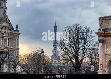 Sunset in Paris, in winter, with Eiffel tower in the far view - Stock Photo